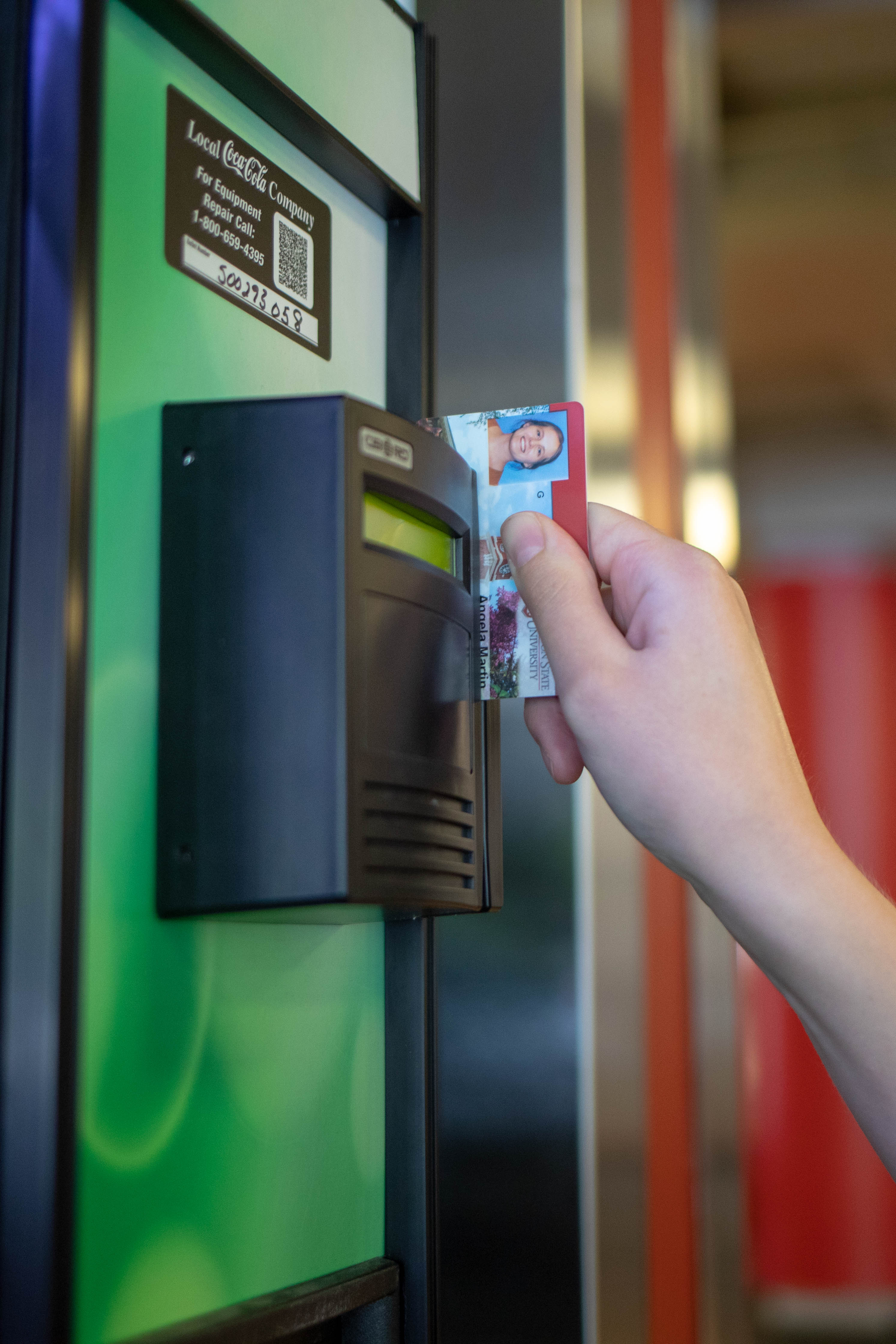 Student using CougarCard in vending machine